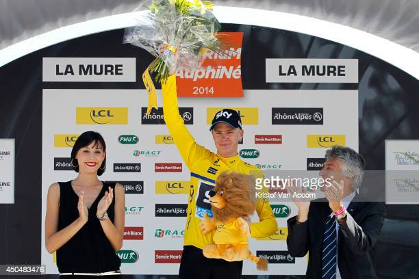 Christopher Froome of Great Britain and Team Sky, wearing the yellow leaders jersey, celebrates on the podium after the fifth stage of the Criterium...