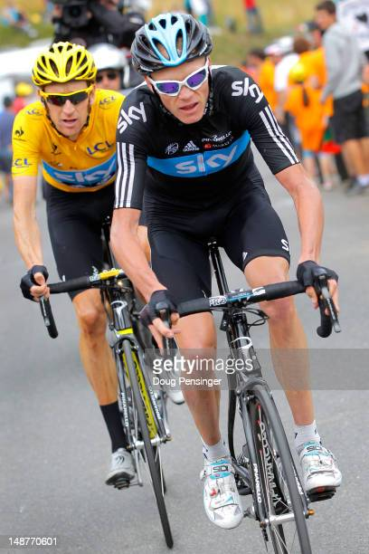 Christopher Froome of Great Britain riding for Procycling escorts team leader Bradley Wiggins of Great Britain in the race leader's yellow on the...