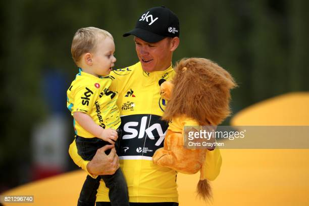 Christopher Froome of Great Britain riding for Team Sky and his son Kellan celebrate on the podium after the overall general classification of the...