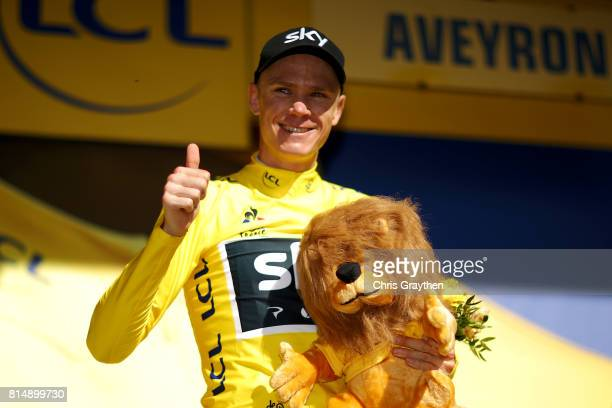 Christopher Froome of Great Britain riding for Team Sky celebrates on the podium after taking the leader's jersey during stage 14 of the 2017 Le Tour...