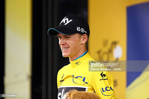 Christopher Froome of Great Britain riding for Team Sky celebrates his yellow jersey on the podium during the 2015 Tour of France, Stage 19,...