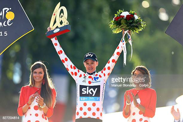 Christopher Froome of Great Britain riding for Team Sky celebrates his polka dot jersey on the podium during the 2015 Tour of France Stage 21 Sevres...