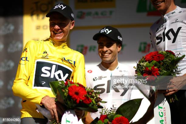 Christopher Froome of Great Britain riding for Team Sky in the leader's jersey and Mikel Landa of Spain riding for Team Sky talk on stage during...
