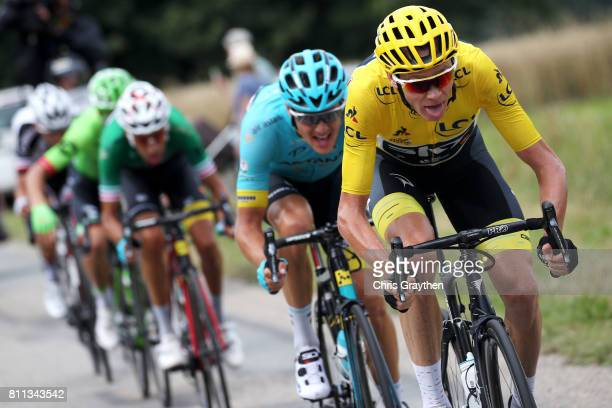 Christopher Froome of Great Britain riding for Team Sky in the leader's jersey rides at the front on the lower slopes of Mont du Chat during stage 9...