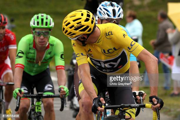 Christopher Froome of Great Britain riding for Team Sky in the leader's jersey looks back at Rigoberto Uran of Colombia riding for Cannondale Drapac...