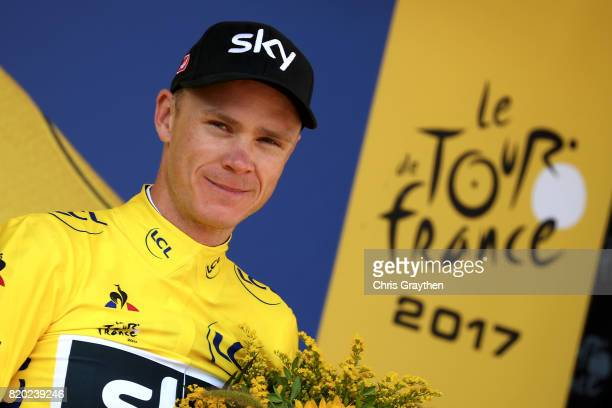 Christopher Froome of Great Britain riding for Team Sky in the leader's jersey poses for a photo on the podium following stage 19 of the 2017 Le Tour...
