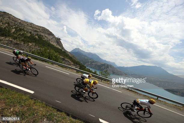 Christopher Froome of Great Britain riding for Team Sky in the leader's jersey rides in the peloton during stage 19 of the 2017 Le Tour de France a...