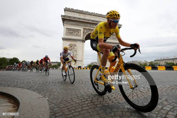 Christopher Froome of Great Britain riding for Team Sky in the leader's jersey rides past the Arc de Triomphe during stage 21 of the 2017 Le Tour de...