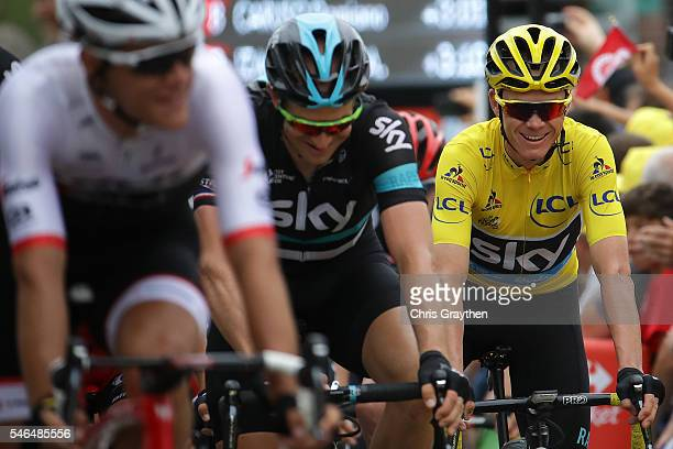 Christopher Froome of Great Britain riding for Team Sky in the yellow leader's jersey rides in the peloton at the finish of stage ten of the 2016 Le...