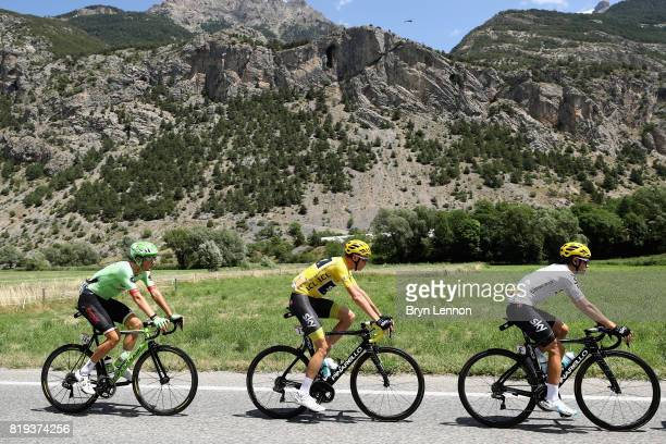 Christopher Froome of Great Britain riding for Team Sky in the yellow jersey rides with Mikel Landa of Spain riding for Team Sky and Dylan Van Baarle...