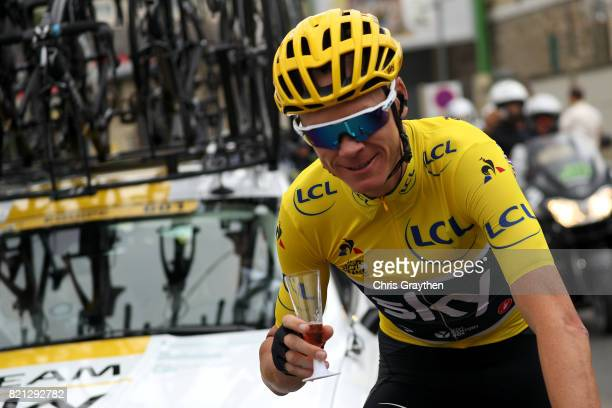 Christopher Froome of Great Britain riding for Team Sky in the yellow leader's jersey celebrates his fourth General Classification overall victory...