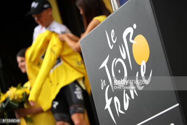 Christopher Froome of Great Britain riding for Team Sky poses for a photo in the leader's jersey on the podium following stage 9 of the 2017 Le Tour...