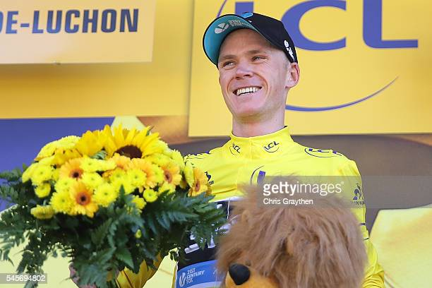 Christopher Froome of Great Britain riding for Team Sky stands on the podium after winning stage eight and taking the yellow leader's jersey of the...