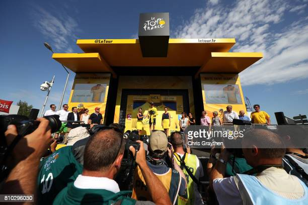 Christopher Froome of Great Britain riding for Team Sky stands on the podium in the leader's jersey following stage seven of the 2017 Le Tour de...