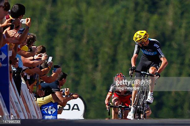 Christopher Froome of Great Britian riding for Sky Procycling takes a look back at Cadel Evans of Australia riding for BMC Racing as Froome sprinted...
