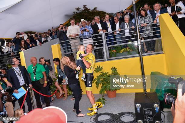 Christopher Froome of Team Sky celebrates his victory with his son during the stage 21 from Montgeron to Paris at Avenue Des Champs Elysees on July...