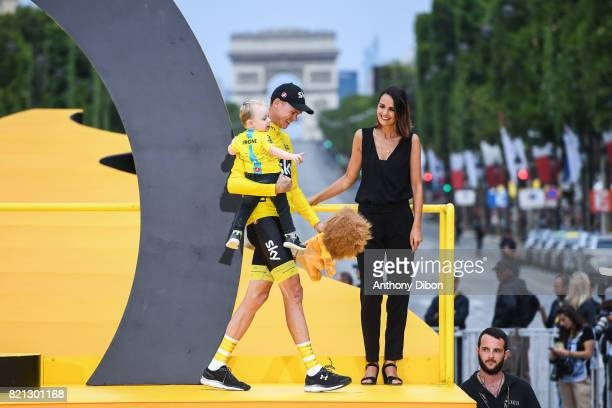 Christopher Froome of Team Sky celebrates the victory with his son during the stage 21 from Montgeron to Paris at Avenue Des Champs Elysees on July...