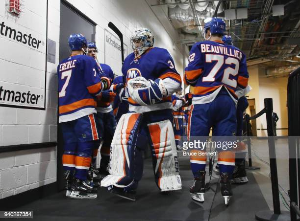Christopher Gibson of the New York Islanders heads out for warmups prior to the game against the Toronto Maple Leafs at the Barclays Center on March...