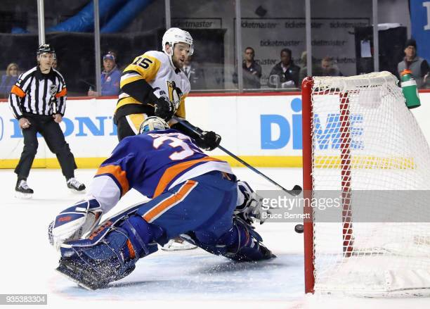 Christopher Gibson of the New York Islanders makes the first period stop on Riley Sheahan of the Pittsburgh Penguins at the Barclays Center on March...