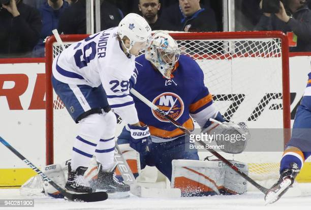 Christopher Gibson of the New York Islanders makes the second period save as William Nylander of the Toronto Maple Leafs looks for the rebound at the...
