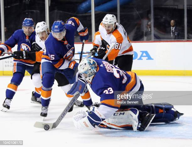 Christopher Gibson of the New York Islanders makes the third period save against the Philadelphia Flyers at the Barclays Center on September 18 2018...