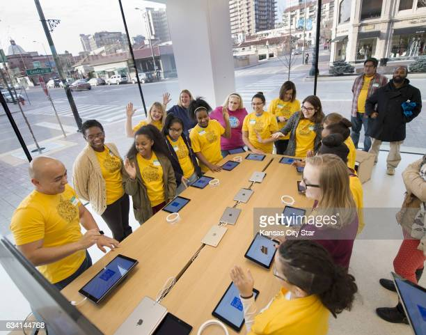 Christopher Gonzalez left a creative at the Apple store on the Country Club Plaza provides some insight for members of the Girls Who Code club during...
