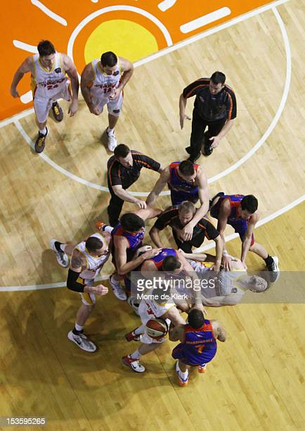 Christopher Goulding of the Tigers is pushed by Anthony Petrie of the 36ers that caused an allin team scuffle during the round one NBL match between...