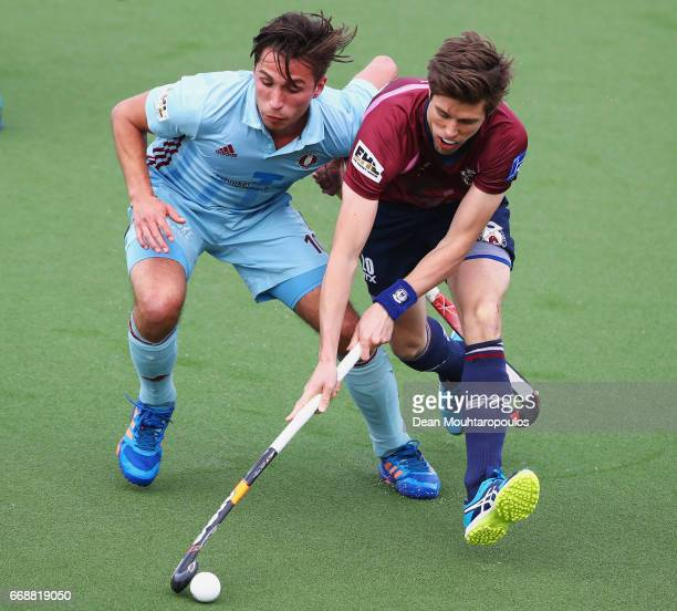 Christopher Gregg of Wimbledon battles for the ball with u10 of UHC Hamburg during the Euro Hockey League KO16 match between Wimbledon and UHC...