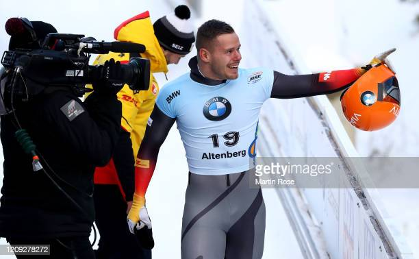 Christopher Grotheer of Germany celebrates after winning the gold medal after the fourth heat for the Men's Skeleton on day eight of the BMW IBSF...