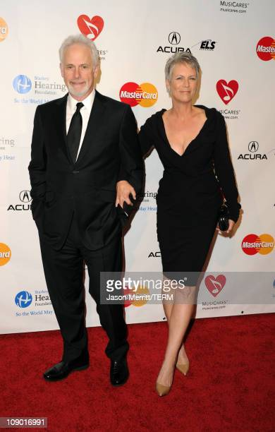 Christopher Guest and actress Jamie Lee Curtis arrive at the 2011 MusiCares Person of the Year Tribute to Barbra Streisand held at the Los Angeles...