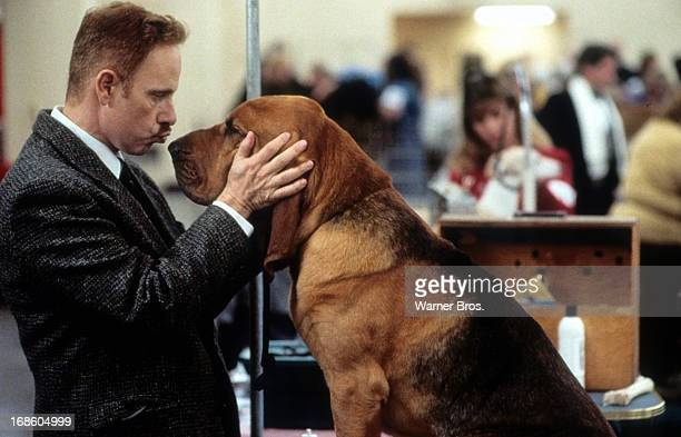 Christopher Guest ready to kiss a dog in a scene from the film 'Best In Show', 2000.