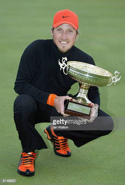 Christopher Hanell of Sweden celebrates winning the Madeira Island Open held on March 28 2004 at the Santo da Serra Golf Club in Fuchal Madeira...