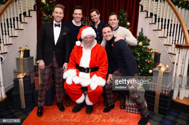 Christopher Hanke Erich Bergen Andrew Rannells Michael Doyle and Max von Essen pose with Santa as Brooks Brothers celebrates the holidays with St...