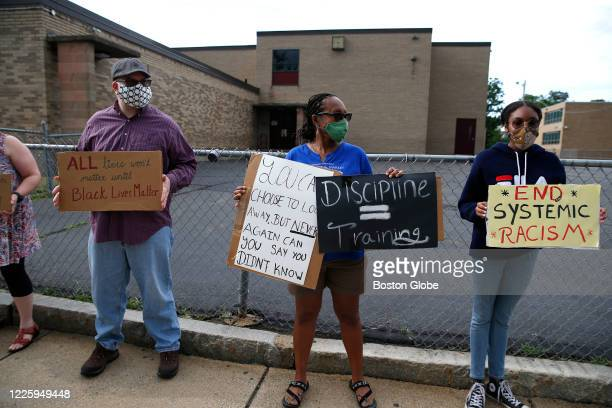 Christopher Hickey Andrea Henry and her daughter Thora protest outside of Mystic Valley Regional Charter School in Malden MA on July 1 2020 Mystic...