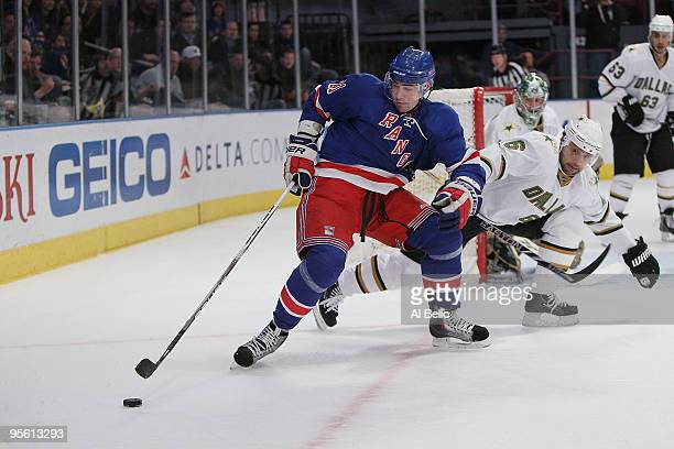 Christopher Higgins of the New York Rangers and Trevor Daley of the Dallas Stars battle for the puck during their game on January 6 2010 at Madison...