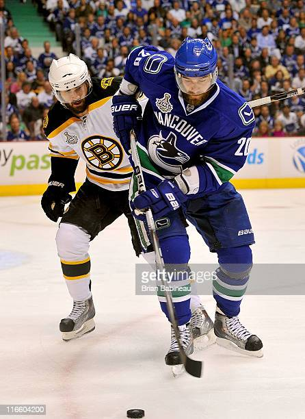 Christopher Higgins of the Vancouver Canucks plays against Johnny Boychuk of the Boston Bruins during the second period of Game Seven of the 2011 NHL...