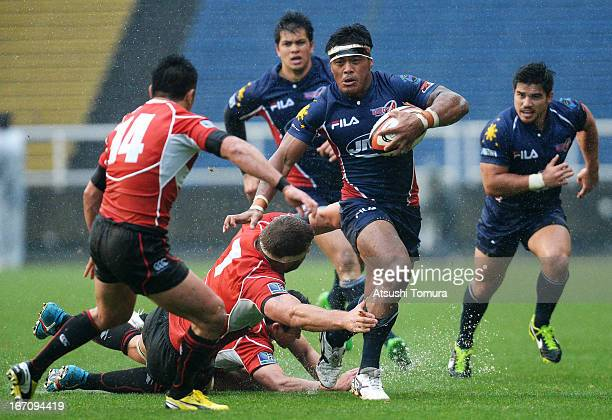 Christopher Hitch of Philippines is tackled by Michael Broadhurst of Japan during the Asian 5 Nations match between Japan and the Philippines at...