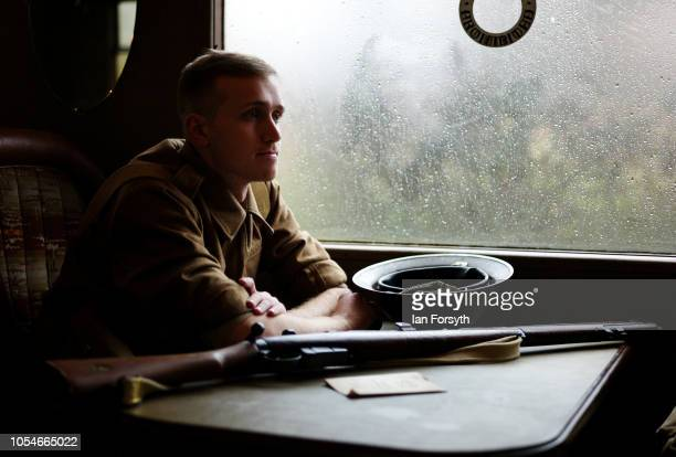 Christopher Hopkins from Chesterfield dresses as a World War Two soldier as he heads to Pickering during the North Yorkshire Moors Railway 1940's...