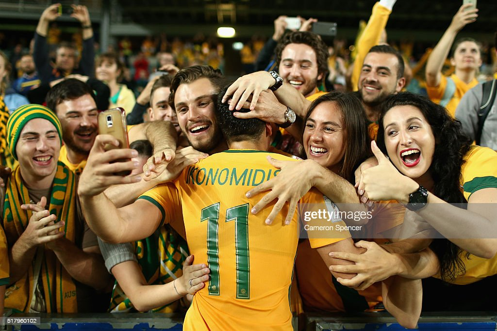Christopher Ikonomidis of Australia celebrates with fans after winning the 2018 FIFA World Cup Qualification match between the Australian Socceroos and Jordan at Allianz Stadium on March 29, 2016 in Sydney, Australia.