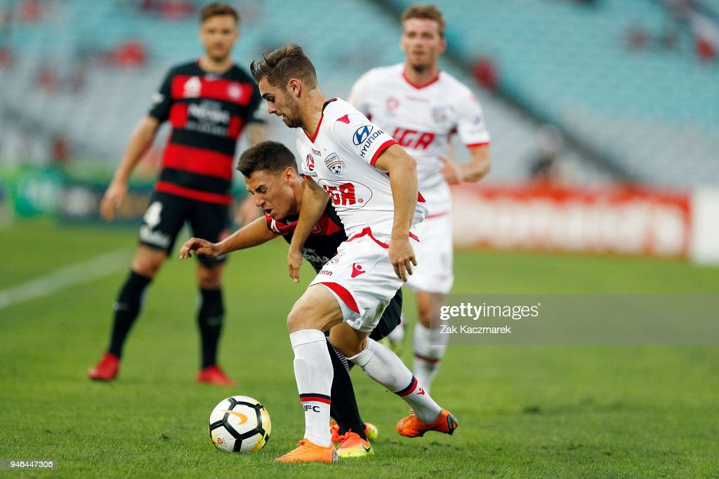Christopher Ikonomidis of the Wanderers is challenged by Benjamin Garuccio of Adelaide during the round 27 A-League match between the Western Sydney Wanderers and Adelaide United at ANZ Stadium on April 15, 2018 in Sydney, Australia.