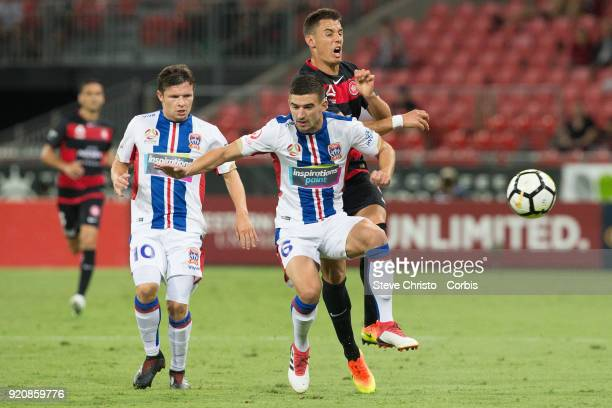 Christopher Ikonomidis of the Wanderers runs into Jets Steven Ugarkovic during the round one ALeague match between the Western Sydney Wanderers and...