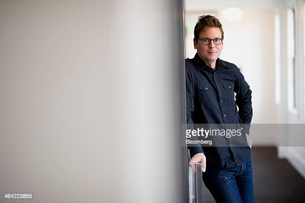 Christopher Isaac Biz Stone chief executive officer of Jelly Industries Inc and cofounder of Twitter Inc stands for a photograph after a Bloomberg...