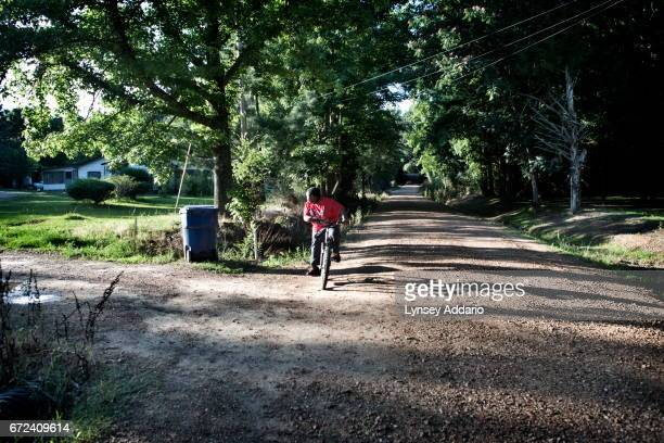 Christopher Jackson rides his bike to meet with his neighborhood friends in Holmes County at the edge of the Mississippi Delta May 31 2012...