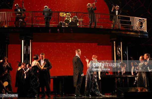 Christopher Job center and Erica Petrocelli center right perform in Los Angeles Opera's production of Verdi's La Traviata at the Dorothy Chandler...