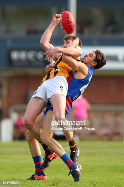 Christopher Jones of Box Hill is tackled by Hugh Sandilands of Port Melbourne during the round seven VFL match between Port Melbourne and Box Hill at...