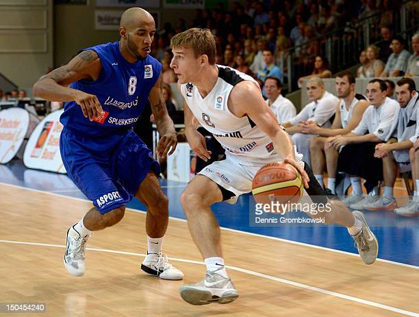 Christopher Jones of Luxembourg and Heiko Schaffartzik of Germany battle for the ball during the EuroBasket 2013 Qualifier match between Germany and...
