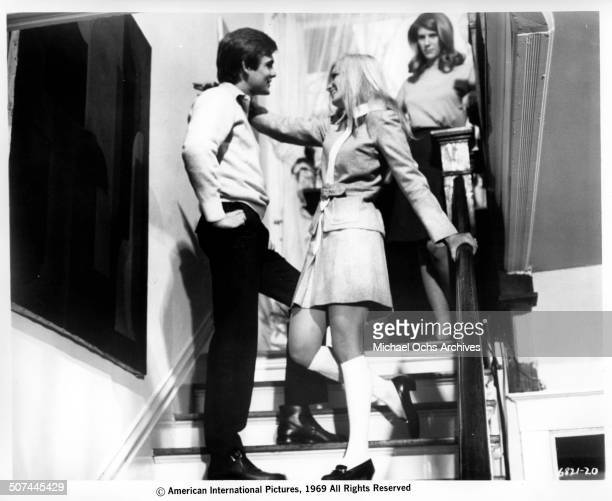 Christopher Jones talks with Yvette Mimieux as Maggie Thrett looks on in a scene from the movie Three in the Attic circa 1969