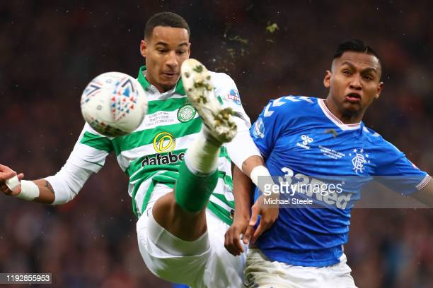 Christopher Jullien of Celtic clears from Alfredo Morelos of Rangers during the Betfred Cup Final between Rangers FC and Celtic FC at Hampden Park on...