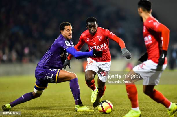 Christopher Jullien of Toulouse and ChristEmmanuel Maouassa of Nimes during the Ligue 1 match between Nimes and Toulouse at Stade des Costieres on...