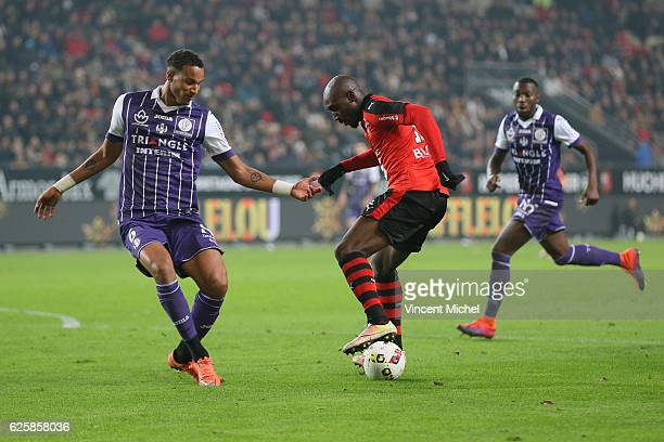 Christopher Jullien of Toulouse and Giovanni Sio of Rennes during the French Ligue 1 match between Rennes and Toulouse at Roazhon Park on November 25...